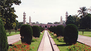 image of a path leading through a rich garden