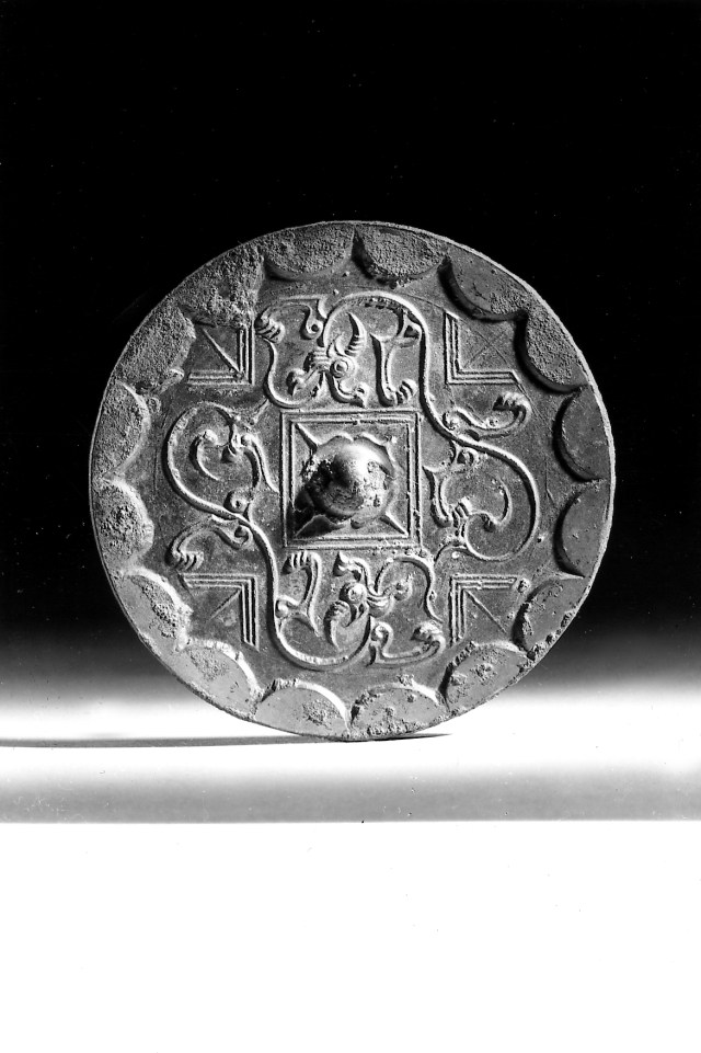 Photo, Bronze mirror. Western Han dynasty, 3rd–2nd century BCE., Diam: 10.2 cm. (4 in.) Singer catalogue number: [1006].