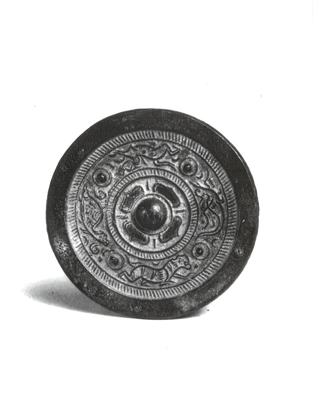 Photo, Bronze mirror. Eastern Han dynasty, 1st century CE., Diam: 6.4 cm. (2 1/2 in.) Singer catalogue number: [1026].