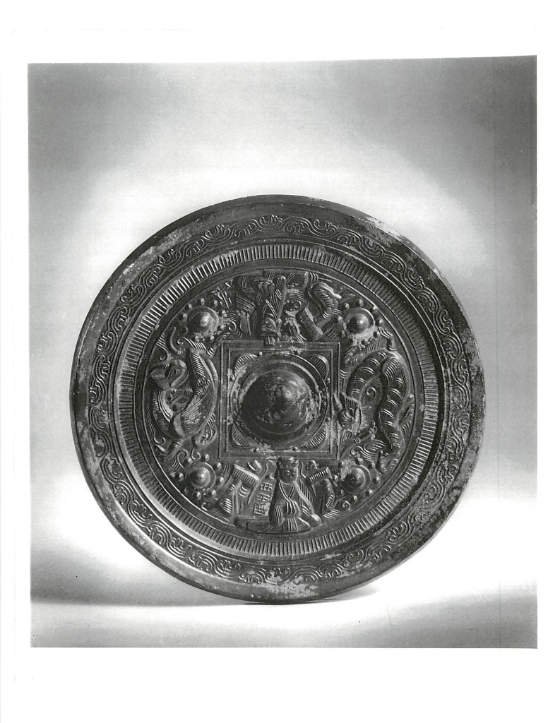 Photo, Bronze mirror. Eastern Han dynasty, 1st–3rd century CE., Diam: 19.7 cm. (7 3/4 in.) Singer catalogue number: [1033].