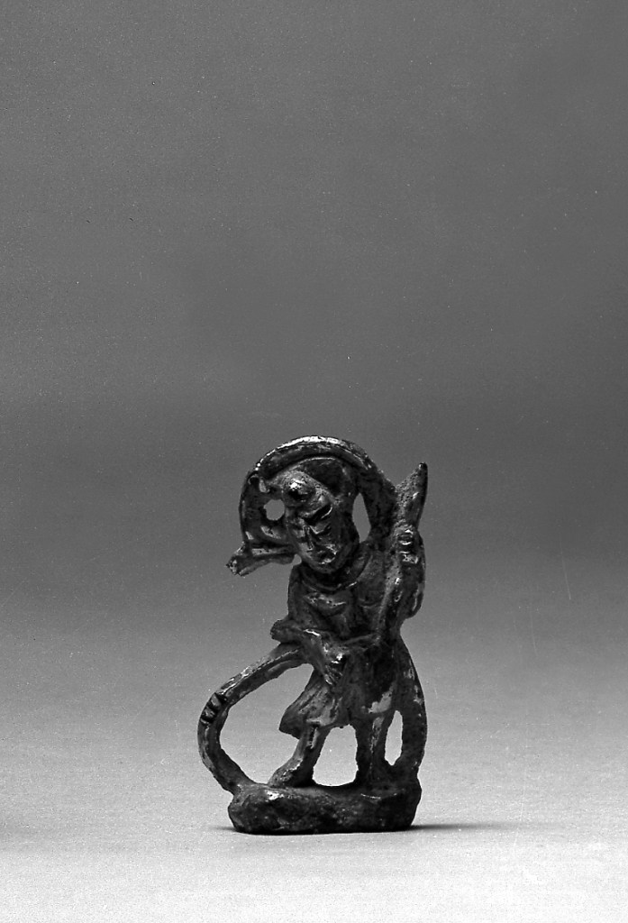 Photo, Gilt bronze Vajrapani. Tang dynasty, 7th century or earlier., H: 4.4 cm. (1 3/4 in.) Singer catalogue number: [1353].