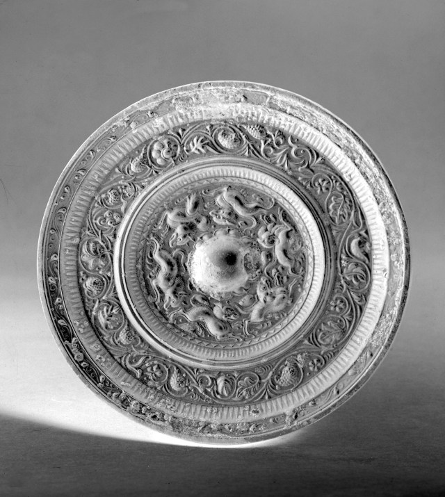 Photo of Bronze mirror. Tang dynasty, 7th century., Diam: 13.1 cm. (5 1/8 in.). Singer catalogue number: [1408].