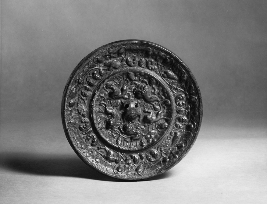 Photo of Bronze mirror. Tang dynasty, 7th century., Diam: 12.1 cm. (4 3/4 in.). Singer catalogue number: [1411].