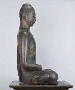 side view of a seated buddha