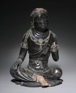 A dark, leaning bodhisattva, seated