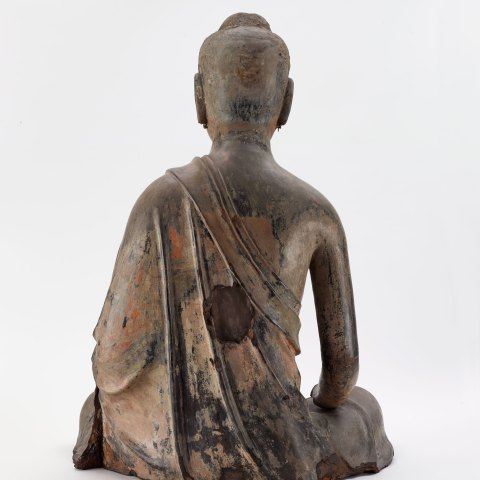 back of seated buddha sculpture