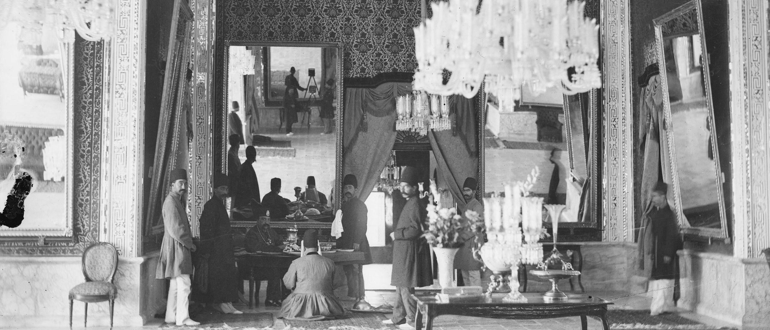 Photo, Tehran (Iran): Kakh-i Sahibqaraniyya (Sahibqaraniyya Palace), Talar-i Ayena (Hall of Mirrors): Nasir Al-Din Shah at his Desk Sevruguin, Antoin, 1880-1930, b&w ; 17.7 cm. x 13 cm. FSA_A.4_2.12.GN.03.06