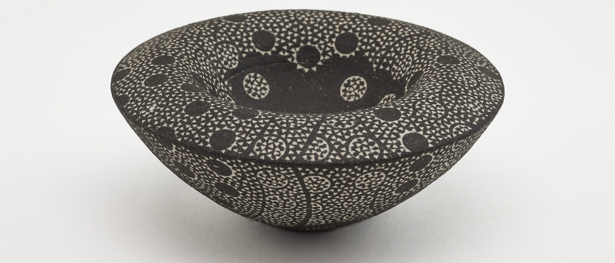 Photo of Double-walled bowl; Kitamura Junko (b. 1956); Japan, Kyoto, 2004; Black stoneware with white slip inlay; Gift of Halsey and Alice North; Arthur M. Sackler Gallery S2017.23