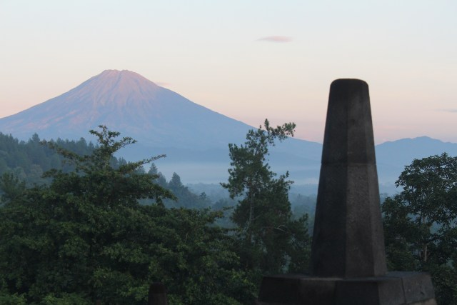 Mt. Merapi, seen from Borobudur, had a devastating eruption in 2010 that covered the monument with ash.