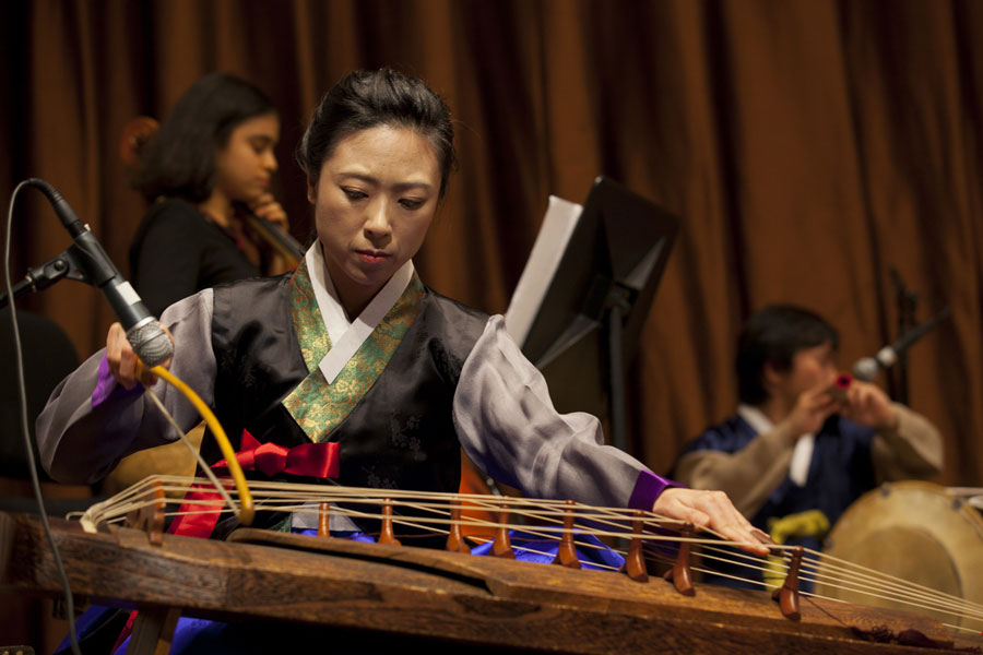 Musician playing bowed zither
