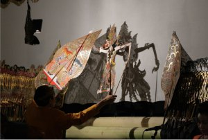 Wayang puppets and their shadows.