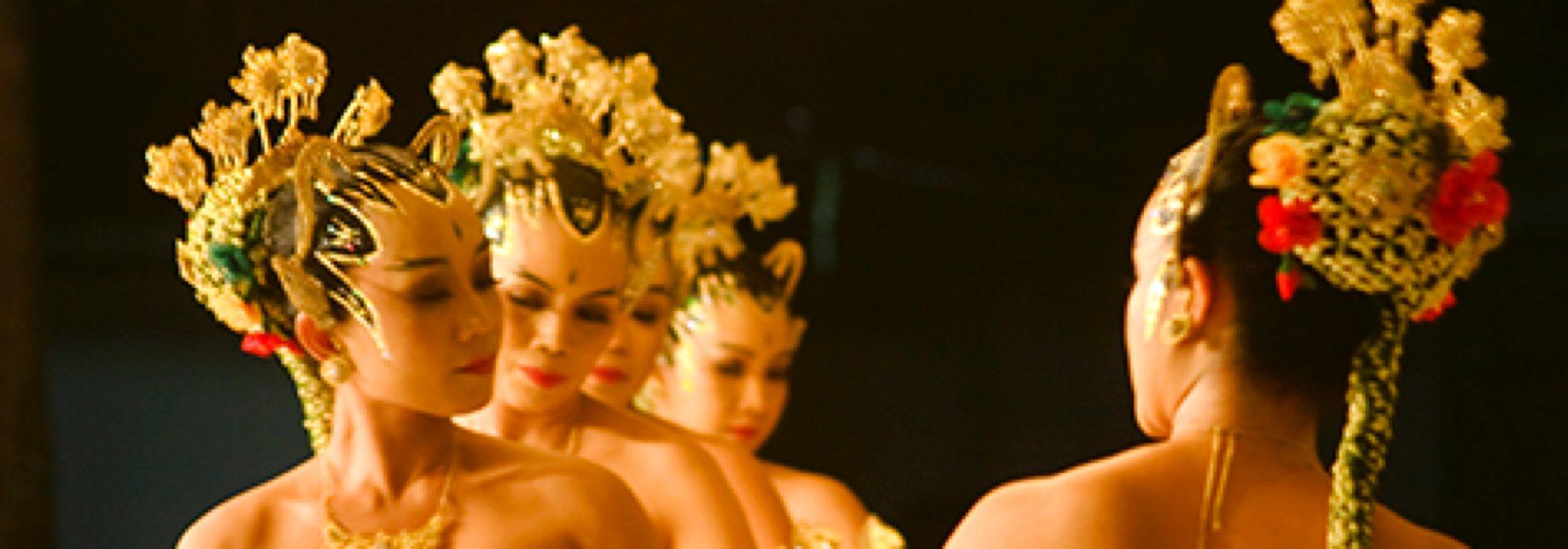 Dancers wearing gold headdresses.