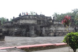 Large stone temple complex with relief carvings in a monumentified area