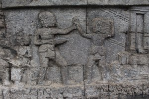 Relief showing two people fighting
