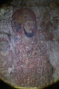 Fresco painting of a man wearing a red and white robe