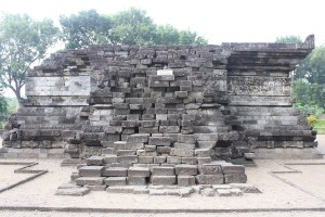 Platform of a temple with a ruined staircase leading up and relief carvings on all sides