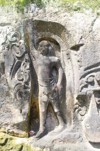 Relief showing man holding up his arm