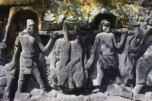 Relief showing men carrying dead animals on a pole