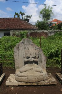Sculpture of seated deity missing head