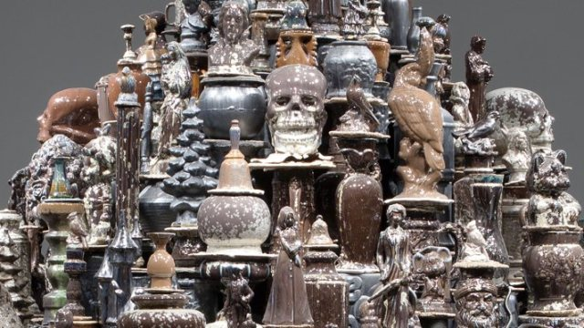 A mountain of brown and black glazed manufactured ceramic objects