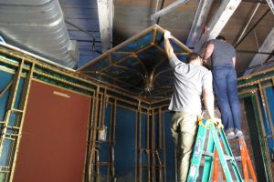 Crew deinstalling the ceiling