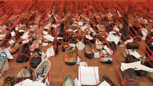 Shoes with notes and red strings