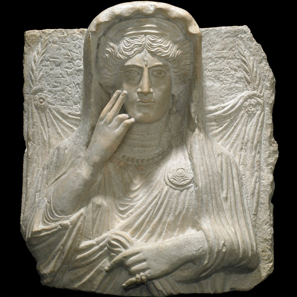carved stone figure of a female