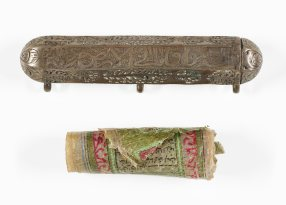 amulet case and rolled up decorated scroll