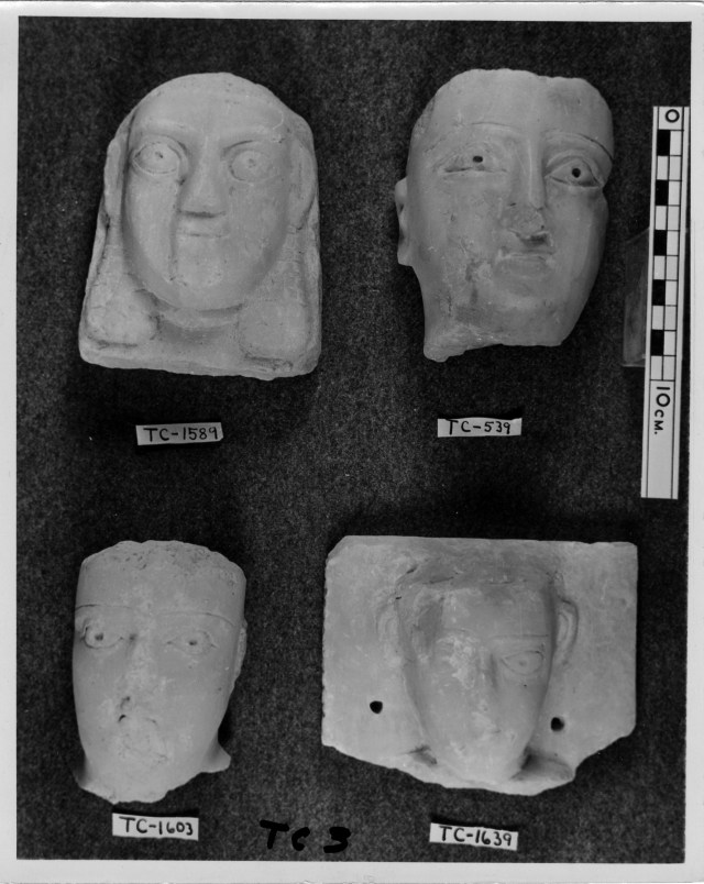 Four carved heads
