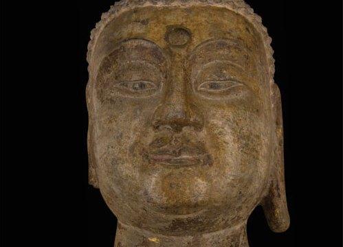 Stone head depicting a buddha