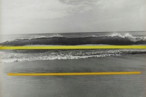black and white photo of waves and sky with a bright yellow line in the middle tracing the horizon and a smaller bright orange line on the bottom quarter of the composition