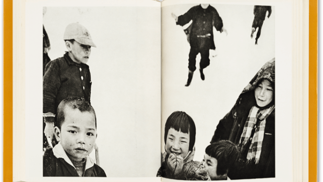sample spread from Warabegoyomiphotobook showing two pages of a book, a black and white photograph across both pages, with seveal chilren, one laughing, the others looking on
