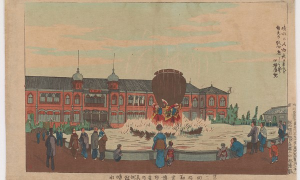 People gather around a grand fountain in front of the Ueno Museum.