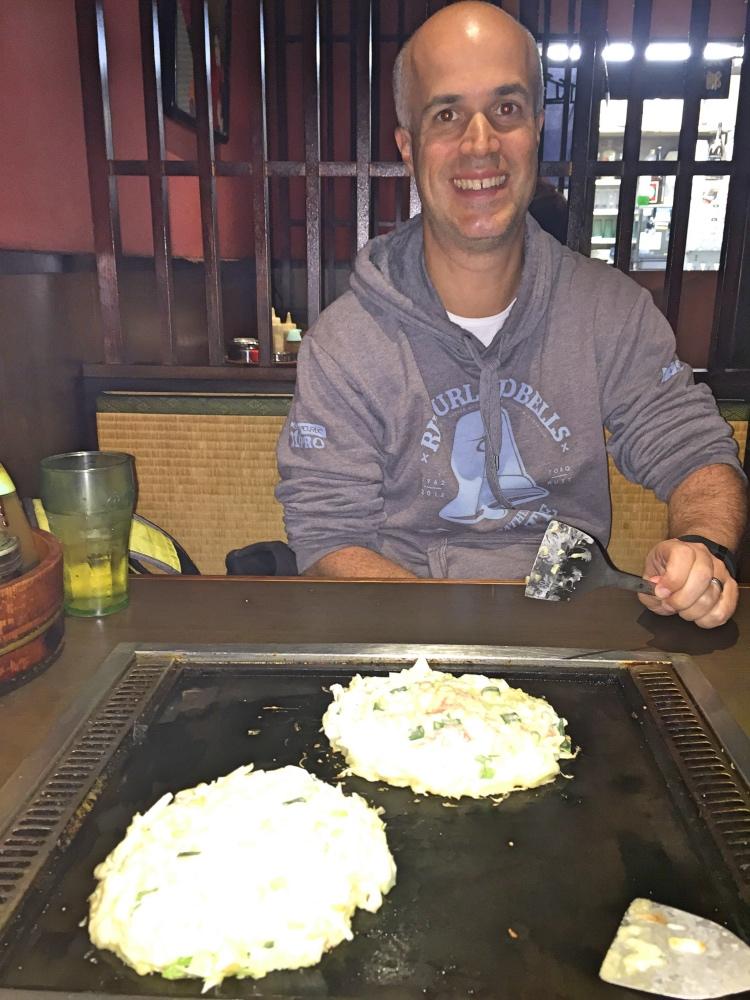 Simon cooking out Okonomiyaki.