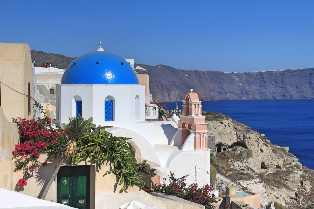 A blue roofed church in Oia