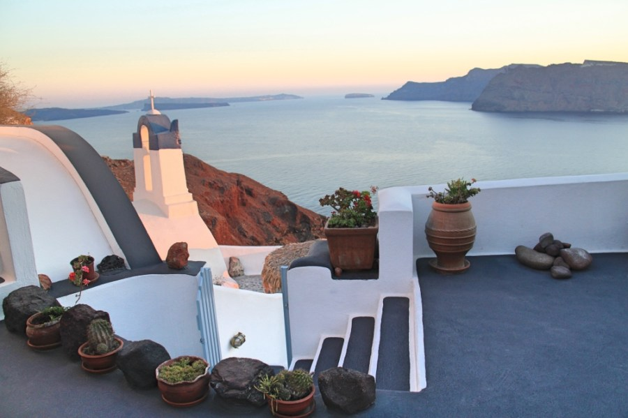The sun is setting on Santorini.