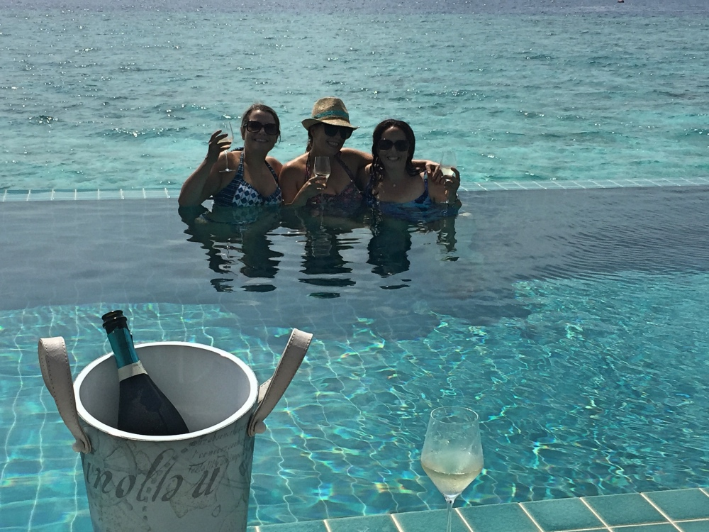 Drinking sparkling wine in Charlotte's pool!