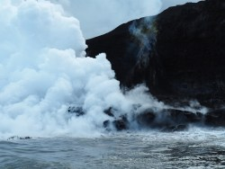 Steam from the lava hitting the water.