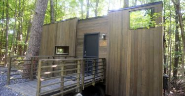 The Gateway Isidore wheelchair accessible tiny house in a beautiful forest.