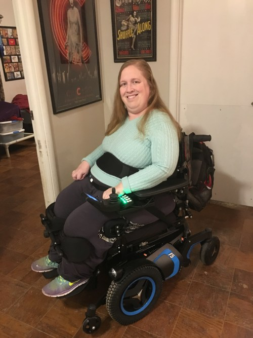Karin sitting in her Permobil F5 VS power wheelchair.