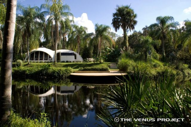 Example of a secluded housing near a small intercity lake with water fountains (The Venus Project)
