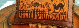Halloween Fence Cat free cross stitch pattern from Jaunty Fox Designs