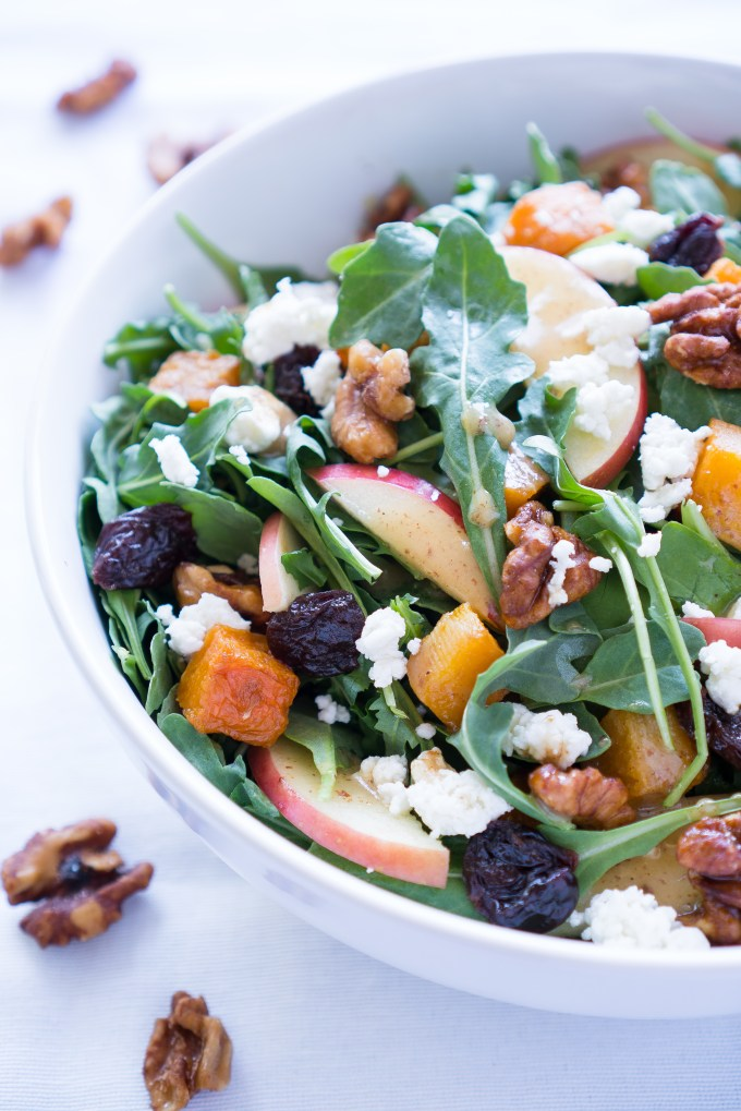 Roasted Butternut Squash Salad - Healthy recipe for Roasted Butternut Squash Salad with arugula! Paired with fresh apple, dried tart cherries, goat cheese, candied walnuts, & a homemade maple vinaigrette ♥ | freeyourfork.com