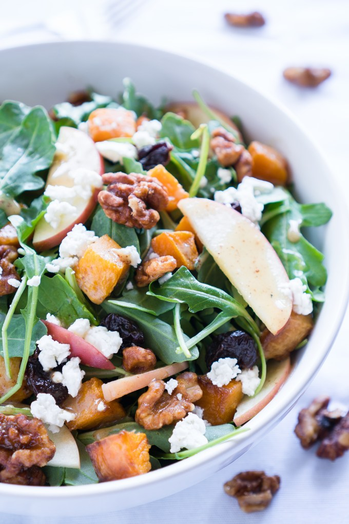Roasted Butternut Squash Salad - Healthy recipe for Roasted Butternut Squash Salad with arugula! Paired with fresh apple, dried tart cherries, goat cheese, candied walnuts, & a homemade maple vinaigrette ♥   freeyourfork.com