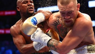 Money Mayweather wins via 10th-Round TKO 50-0