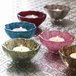 Set of six scalloped edge tea light holders