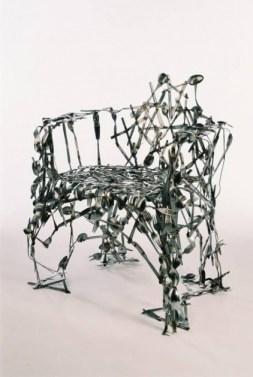 Unusual wacky weirdd chair handmade from cutlery