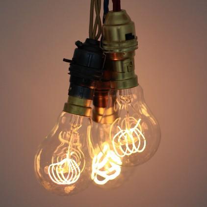 Quad loop carbon filament designer light bulb