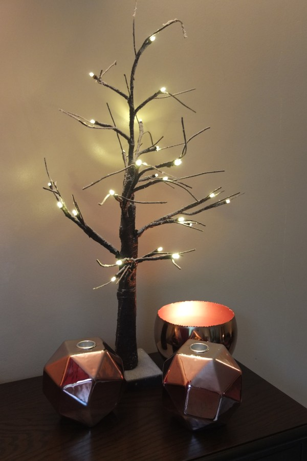 Create a cosy winter dining room with copper and wood