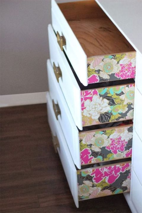 Wallpaper looks really effective used to pretty up the sides of drawers